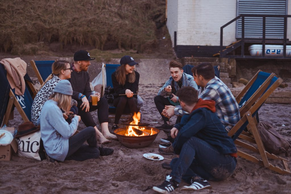 Friends having a barbecue on a beach.
